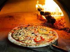 23994592-close-up-pizza-in-firewood-oven-with-flame-behind.jpg 450×333 pixels