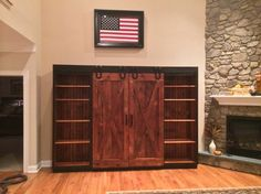 Sliding barn door entertainment center wonderful cabinet with doors rustic family room diy Barn Door Tv Cabinet, Barn Door Bookcase, Double Sliding Barn Doors, Diy Barn Door, Diy Entertainment Center, Room Doors, Interior Barn Doors, Rustic Interiors, Entertaining