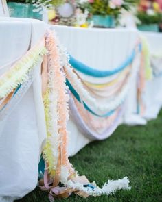 Bright fringe and garlands draped along the outside of tables