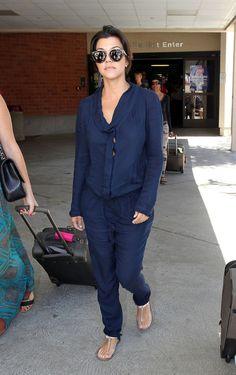Kourtney Kardashian wearing Fendi Jelly Flat Thong Sandal Celine CL41043/S New Pretty Sunglasses Burbank Airport September 1 2013