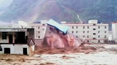 A building collapses amid floodwaters caused by torrential rain in Deyang City, Shifang County, Sichuan Province, July 9, 2013 in this still image taken from video. Floods caused by heavy rains swept away houses and bridges in China's southwest Sichuan Province, state media reported. Video shot on July 9, 2013. REUTERS/CCTV via Reuters TV Posted by floodlist.com