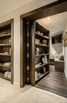 I love me a hidden room! Though this isn't the best design -- in order for this to be functional, every single thing on that bookshelf would need to be glued down, or it would fall off when it swung open.
