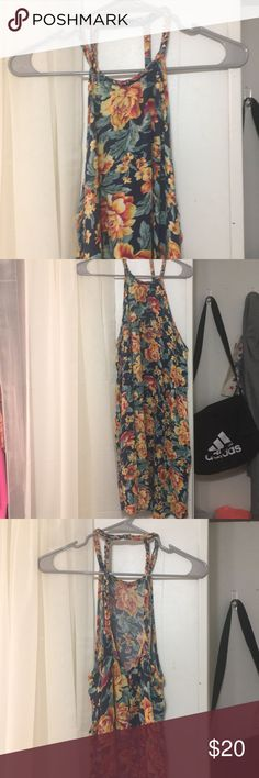 American Eagle Floral Dress This dress is in perfect condition. It has been worn once to a show- absolutely no signs of wear. Super soft and the braided detailing is super cute. Make an offer! American Eagle Outfitters Dresses