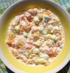 FIVE CUP SALAD  1 cup pineapple tidbits or chunks (drained) 1 cup mandarin segments drained (10 oz can = 1 cup) 1 cup shredded coconut 1 cup low fat sour cream 1 cup mini coloured marshmallows  Mix all together and refrigerate for a few hours, overnight is best!
