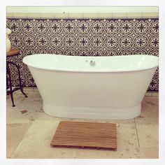 All products available at Schots based in Melbourne, Australia. Pictured is our Cast Iron Eiffel Bath (https://www.schots.com.au/eiffel-cast-iron-bath-gloss-white-kaibbcieiwh.html), Sirian Encaustic Tile Splashback (https://www.schots.com.au/siran-encaustic-feature-tile.html), Teak Bath Mat (https://www.schots.com.au/teak-bath-mat-kai53abg909a.html) & Turkish Travertine Tiles (https://www.schots.com.au/1-5cm-thick-villa-tumbled-travertine-tile-beige-kai05btvbt15.html)
