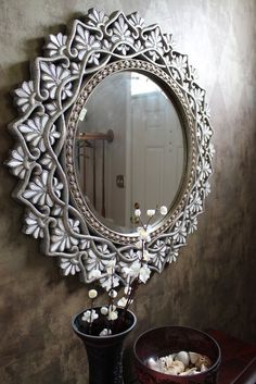 Pier 1 mother-of-pearl mirror in an entryway