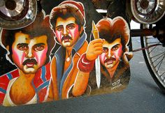 Anil Kapoor in full force, On CG Rd., Ahmedabad.  This is part of a collection of painted mud-flaps of rickshaws & cycle carts in Ahmedabad, Gujarat, India.   Photo: Meanest Indian