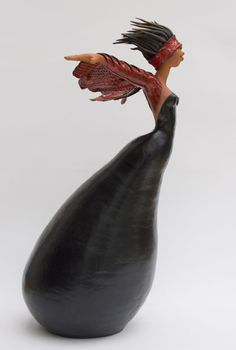 Janneke Bruines. A Ceramic artist, but think about how something like this could be done in a gourd.