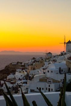 The famous Santorini Sunset in Greece complete with windmill in Oia #greece #santorini #windmill #sunset #oia