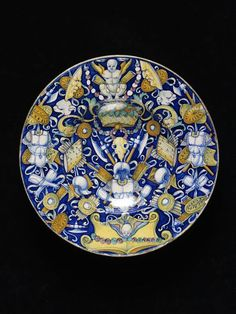 Dish    Place of origin:  The Marches, Italy (made)    Date:  ca. 1520 (made)    Artist/Maker:  Giovanni Maria (painter (artist))    Materials and Techniques:  Tin-glazed earthenware    Credit Line:  Bequeathed by George Salting  V, C.2084-1910