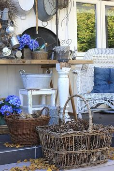 Wicker rockers, blue & white, pine cones. Autumn leaves, tag sale finds...lots for her to love here.