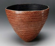 Thin red polished ware of Nubian A-Group. Red painted pattern. Perhaps restored from fragments in 142 /7.