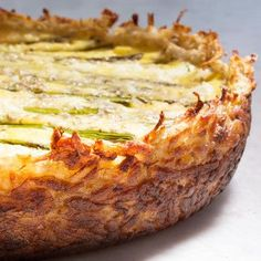 Get all the goodness of hash browns and a rich Fontina and goat cheese egg custard in this unexpected quiche. With fresh green asparagus and tarragon, it's perfect for a springtime brunch, lunch, or light dinner. Asparagus and two cheese quiche. Brunch Recipes, Breakfast Recipes, Brunch Menu, How To Make Quiche, Making Quiche, Cheese Quiche, Goat Cheese, Cheese Dips, Quiche Crust Recipe