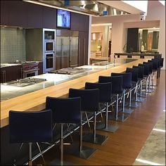 This Sub-Zero Showroom Cooking Class Center is certainly one way to keep kitchen appliance enthusiasm high. Look close to see that a Chef is on duty. Sub Zero, Sitting Area, Cooking Classes, Showroom, Kitchen Appliances, Table, Furniture, Home Decor, Living Room