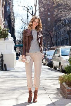 Cream pants, brown booties and leather coat and grey shirt