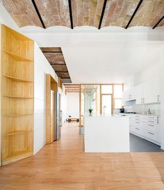 Renovated Barcelona apartment featuring traditional vaulted ceilings.