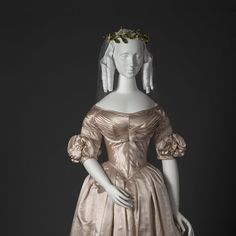 View of wedding dress and detail image.