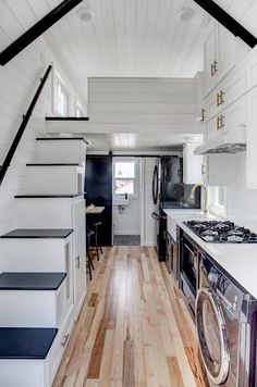 The Kokosing 2: the second version of Modern Tiny Living's Kokosing model. The 256 sq ft tiny house has everything from a queen-sized loft bedroom to a beautiful raised living room.