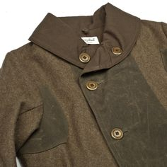 The West is Dead  Mackinaw Jacket Fall 2012  www.thewestisdead.com      Heavy military inspired wool coat. 100% cotton duck canvas lining with wax canvas accents. Slim fitting shoulders and arms. Welt pockets, corozo nut buttons.   MADE IN THE USA