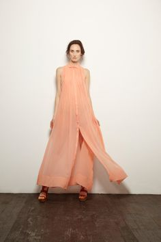 https://www.cityblis.com/item/1714  TURN OF THE TIDE MAXI SHIRT DRESS - MELON - $744 by LP33.3  Amazing washed silk georgette maxi shirt dress by LP33.3 with pleated detailing and a delicate folded collar. Comes with a grosgrain tie so that the dress can be worn cinched or loose, and a separate slip in ivory viscose that accentuates the lush melon colour of the dress. Made in Australia.  #