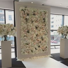 Flower wall wedding ceremony background - would also be a great photobooth backdrop