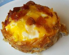 Shredded hash browns pressed into muffin tin; salt and pepper to taste, add shredded cheese, bake in oiled muffin tin for 15 mins at 425. Reduce heat to 350 add egg and bacon pieces and some cheese on top bake 15 to 18 additional mins