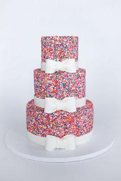 Girly Sprinkle Cake - White Velvet Cake (CakeMommyTX's recipe) with Oreo buttercream and TONS of sprinkles!