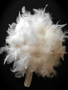 feathers; Jerrica!!! I made you a bouquet like this way before pinterest existed!!! I ROCK!