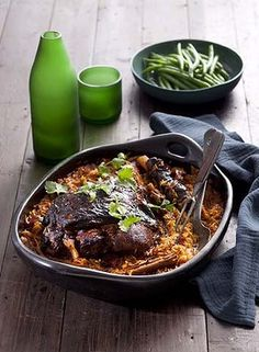 Greek tomato-baked lamb with orzo.