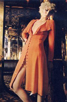 Orange crepe dress at Bus Stop. Orange suede sandals at Elliott.,  photographed at the Chelsea Drug Store by Hans Feurer,  Telegraph Magazine Spring 1970