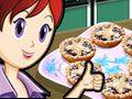 Tortas Natalinas - Sara tem todos os ingredientes e utensílios que você precisa para fazer estas deliciosas tortas natalinas. Basta seguir as instruções dela neste jogo de culinária e completar todas as etapas. Comece fazendo a massa. Você precisa trabalhar rápido, como um mestre confeiteiro. Se for bem rapidinho, ganhará pontos de bônus.