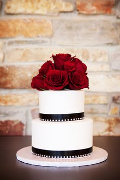 Black, white and red cake! Photo by Sara C. #WeddingCakesMinneapolis