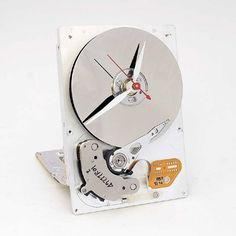 A Clock made from a real 3 computer Hard drive Computer Hard Drive and converted into a desk clock with a quartz drive movement installed. The clock Computer Hard Drive, Retro Games, Desk Clock, Wooden Art, Circuit Board, Design, Craftsman Clocks, Home Decor Ideas, Decorating Ideas