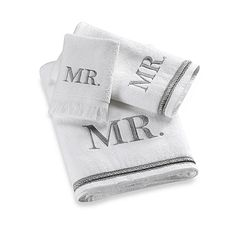 Sheared velour towels are the perfect bridal shower gift. Mr. is spelled out on the bath towel in block lettering in silver thread and coordinated with a silver braid.