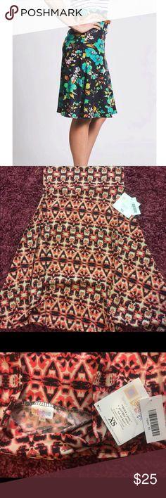 LuLaRoe Azure Skirt XS size. Azure Skirt from LulaRoe. Pinkish/ Salmon color print. LuLaRoe Skirts
