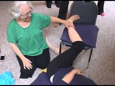Bonnie Working with a Student's Hip Joints with Bonnie Bainbrdige Cohen