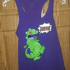 reptar tank & leg warmers purple tank top. racer back style. reptar logo on front, says RAWR ! perfect for my fellow rugrat lovers & 90's babies !! says size M but i am a true S & it was snug on me. the leg warmers were a gift from the posher i bought the tank from, they were toe socks that had holes so I cut them into cute leg warmers. (pic shows front & back of leg warmers) Tops Tank Tops