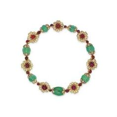AN EMERALD, RUBY AND DIAMOND NECKLACE, BY VAN CLEEF & ARPELS Price realised HKD 1,060,000 USD 137,275 Estimate HKD 400,000 - HKD 600,000 (USD 51,844 - USD 77,766)