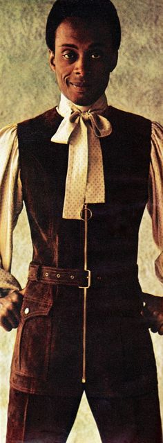Brown suede tunic with patch pockets, belted, by Beged-Or, in leather by Alma & Jacobs. Coffee-brown polka-dot silk shirt with bellow sleeves, tie, collar, by Mr Fish. From Men in Vogue Autumn-Winter 1969 U.K. (minkshmink)
