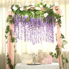 The selection of flowers takes an important place for event decoration arrangements. It is amazing how something as simple as flowers can drastically enhance the look of your event. Make your wedding outstanding with our beautiful collection of flowers Wisteria Wedding, Diy Wedding Flowers, Garland Wedding, Wedding Flower Arrangements, Floral Centerpieces, Wedding Backdrops, Purple Wedding, Wedding Ideas, Wisteria Trellis