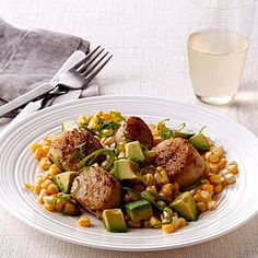 Spiced Scallops with Corn and Avocado, a fast, easy way to serve up fresh seafood and seasonal veggies | health.com
