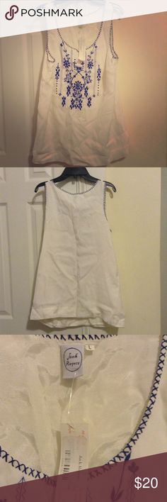 Jack Rogers embroidered tank NWT Jack Rogers embroidered tank top sz L. 100% rayon and fully lined. This seems to run a tad small (no stretch to this piece). I'd say if you want a truly flowy fit it might be better for those who wear a size medium. Open to trades or bundling! Jack Rogers Tops Tank Tops