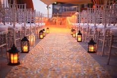 wildflowerarrangements for wedding reception | Lanterns down the ceremony aisle