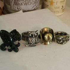 Pick One Ring or Buy Them All! A silver owl Gold cowboy hat Black fleur-de-lis Gold/black with rhinestones  Rings all have stretchy bands (one size fits all) except for cowboy hat  $4 each or $10 for bundle  Great stocking stuffers! Charming Charlie Jewelry Rings