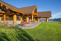 A stunning Pioneer Log Home, overlooking the beautiful Williams Lake, eloquently accented by tasteful landscaping.