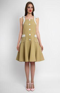 Ribbon-trim thick cotton dress. Front buttons. Patch pockets. Decorative trim with cotton-ribbon shoulder bows. Unlined.