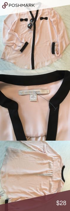 Lauren Conrad Long Sleeve Blouse Top New without tags pale pinky peach long sleeve Lauren Conrad LC blouse top with black accents. Cute little black bows and buttons down the front. Size Large. Love this top for a date night or casual outfit. 😍 LC Lauren Conrad Tops Blouses