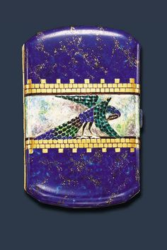 AN ELEGANT ART DECO ENAMEL CIGARETTE CASE, BY VAN CLEEF & ARPELS Of cushion-shaped outline, centering upon a textured blue, green and brown enamelled peacock against a mottled green and mauve enamelled band, within gold brick motif borders, to the blue and gold background, and push-piece, the reverse of similar design, mounted in 18k gold, circa 1925 - Dim: 3¾ x 2½ x ½ ins., with French assay marks and maker's mark - Signed Van Cleef & Arpels, Paris, no. 22997