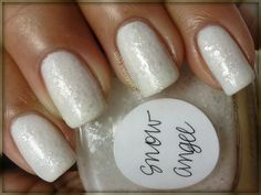Snow Angel by NailsandNoms, via Flickr.  Love the choice of base polish here.