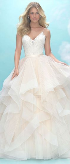 Airy, textured ruffles comprise the skirt of this delicate ballgown.